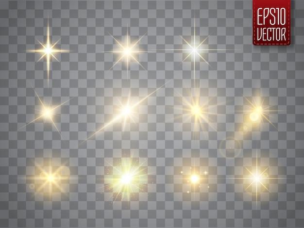 Złote Iskry Na Białym Tle. Wektor świecące Gwiazdy. Flary I Błyski Obiektywu Premium Wektorów
