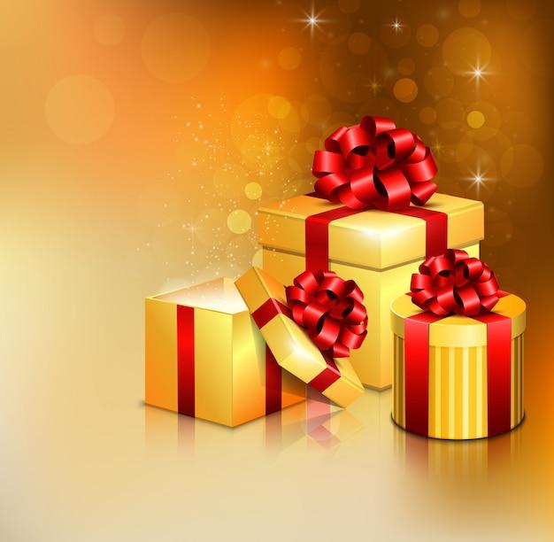 Złote otwarte pudełka z czerwoną kokardą i wstążką Premium Wektorów