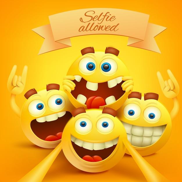 Żółta buźka emoji stoi przed postaciami robiącymi selfie. Premium Wektorów