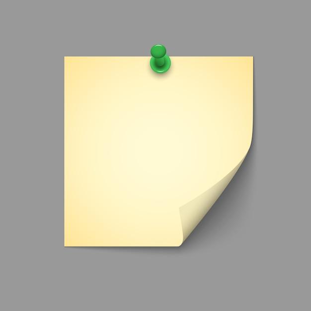 Żółta notatka z zielonym pinezką Premium Wektorów