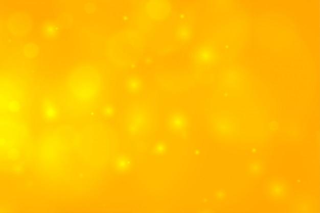 Żółty Bokeh Z Iskrzącymi światłami Darmowych Wektorów