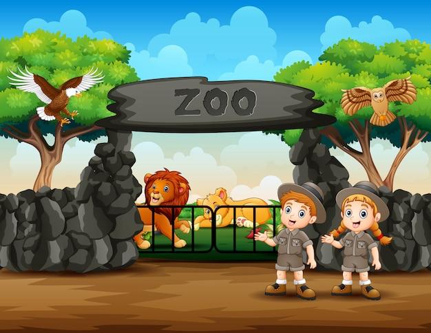 Zookeeper I Dzikie Zwierzęta Przy Zoo Wejścia Ilustracją Premium Wektorów