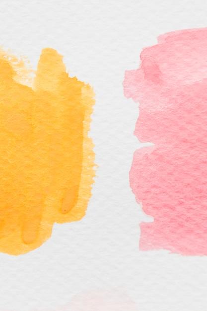 Żółty i czerwony akwarela plama na białym papierze Darmowe Zdjęcia