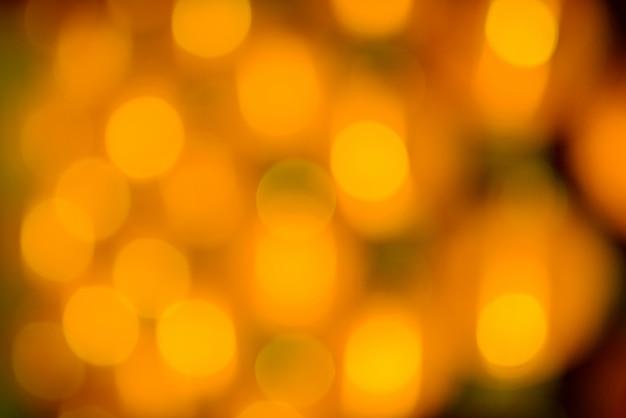 Żółty wakacje bokeh. Abstrakcyjne tło Premium Zdjęcia