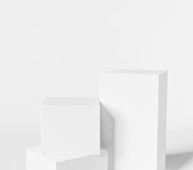 3d Geometryczne Białe Podium Do Lokowania Produktu Z Trzema Białymi Kostkami Premium Zdjęcia