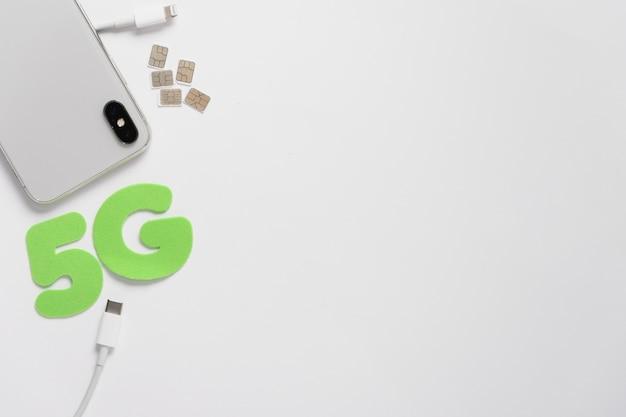 5 G Przeliterowane Za Pomocą Kabla Błyskawicy Premium Zdjęcia