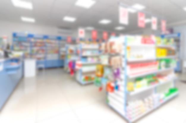 Abstrakcjonistyczna Plamy Półka Z Lekami I Innymi Towarami W Apteka Sklepie Premium Zdjęcia