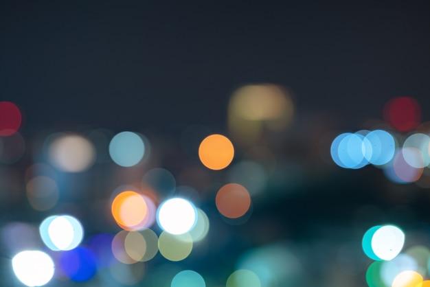 Abstrakcjonistycznego Miastowego Nocy światła Bokeh Defocused Tło Z Niebo Astronautycznym Terenem Premium Zdjęcia