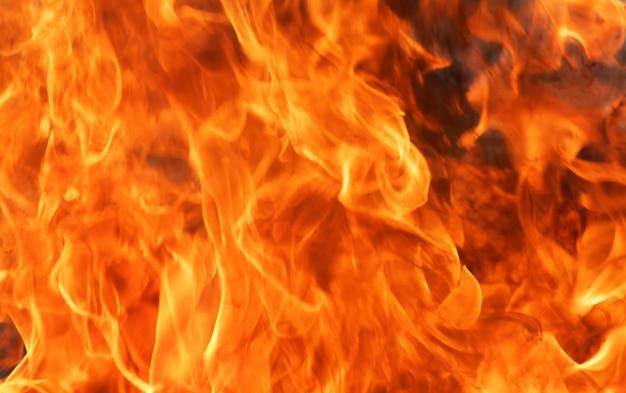 Abstrakcjonistyczny blasku ogienia płomienia tekstury tło. Premium Zdjęcia