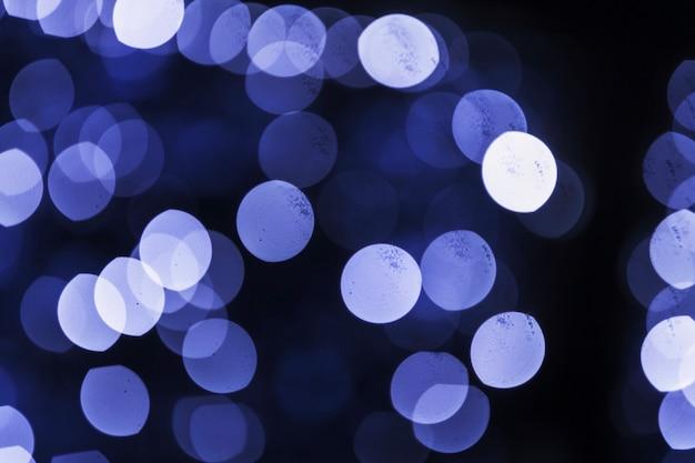 Abstrakcjonistyczny bokeh zamazywał błękita światła tło Darmowe Zdjęcia