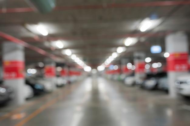 Abstrakcjonistyczny plama samochodowy parking w budynku Premium Zdjęcia