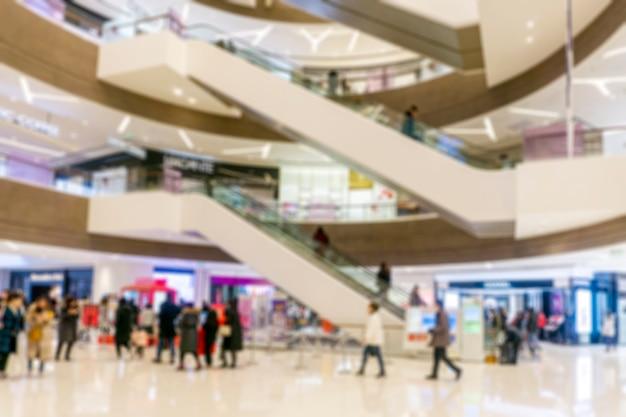 Abstrakcjonistyczny plama zakupy centrum handlowe wydziałowego sklepu wnętrze dla tła Premium Zdjęcia