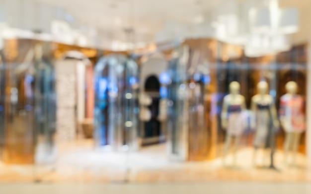 Abstrakcjonistyczny Rozmyty Nowożytny Mod Ubrań Sklep W Luksusowym Zakupy Centrum Handlowym Dla Tła, Ubraniowy Zakupy Pojęcie. Premium Zdjęcia