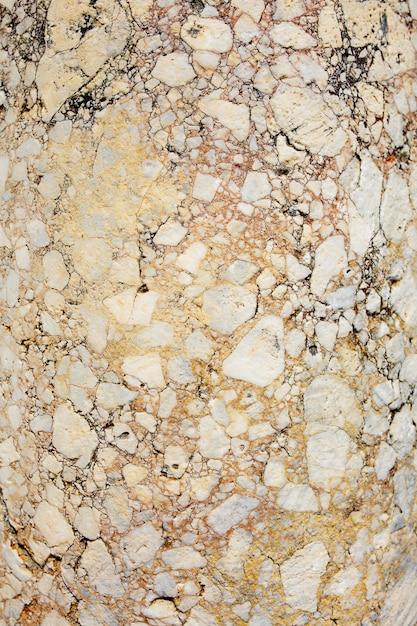 Antyczny różowy marmur z pęknięciami, faktura kamienia Premium Zdjęcia