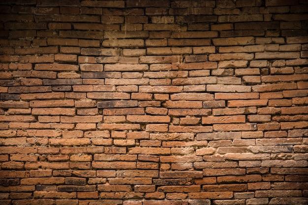 Antyczny stary ściana z cegieł dekadencki tło Premium Zdjęcia