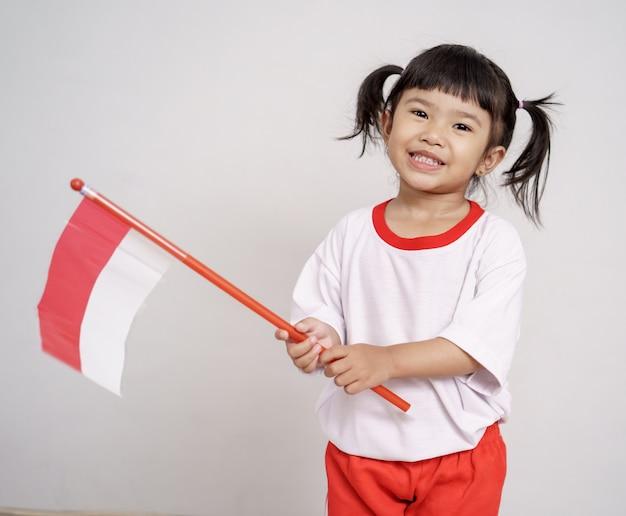 Azjatycki Maluch Z Flagą Indonezji Premium Zdjęcia