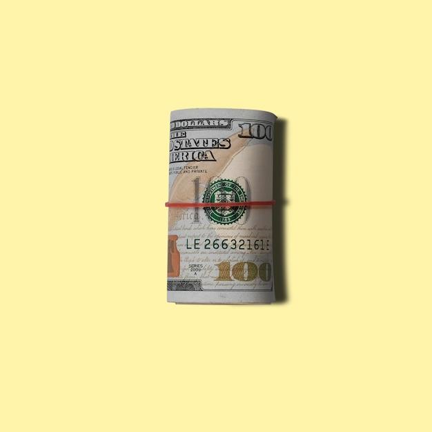 Banknoty Dolarów Amerykańskich Na żółtym Tle Premium Zdjęcia