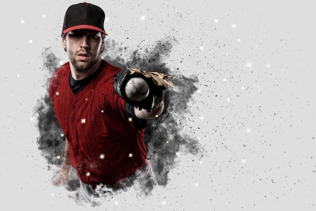 Baseballista W Czerwonym Mundurze Wychodzącym Z Podmuchu Dymu. Premium Zdjęcia