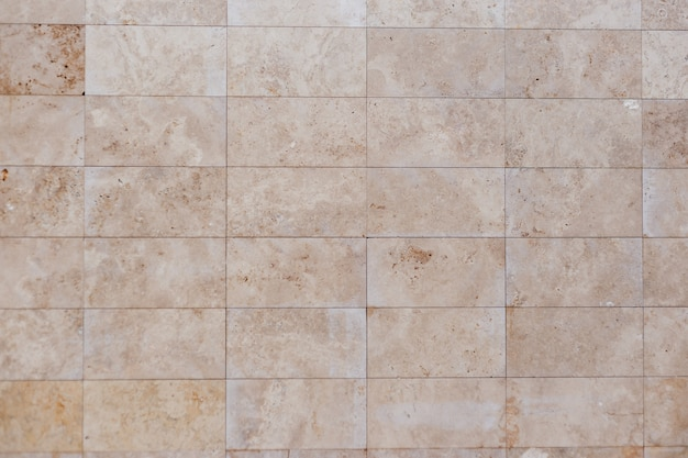 Beżowa ściana Betonowa. Płytka Tekstury Piaskowca Premium Zdjęcia