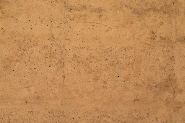 Beżowo-brązowy Betonowy Mur, Faktura Wnętrza Premium Zdjęcia