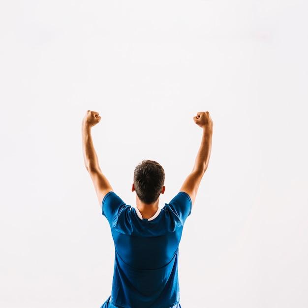 Beztwarzowy Młody Gracz Futbolu świętuje Zwycięstwo Premium Zdjęcia