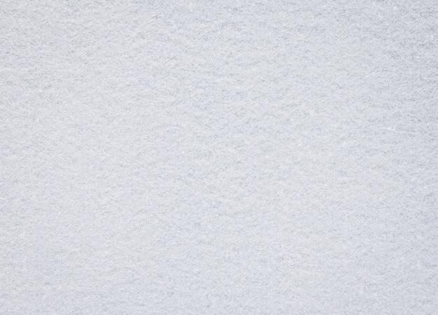 Biała Filcowa Tekstura. Puste Tło Tkaniny. Szczegół Materiału Dywanu. Premium Zdjęcia