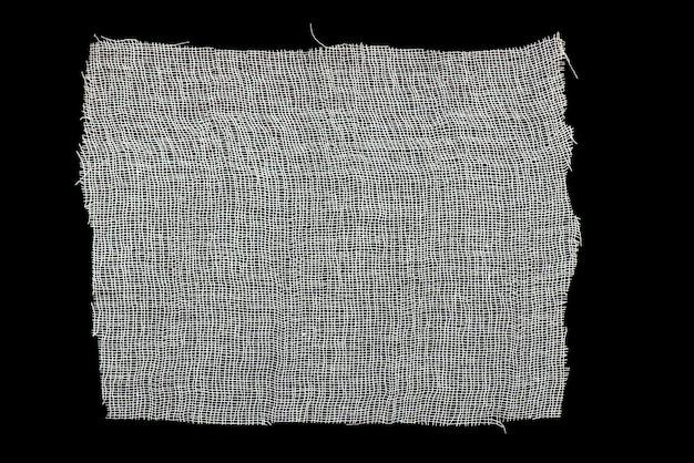 Biała gaza odizolowywająca na czarnym tle jako tekstura Premium Zdjęcia