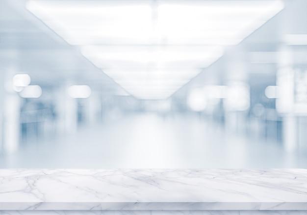 Biała Marmurowa Powierzchnia Na Zamazanym Pustym Biurze Premium Zdjęcia
