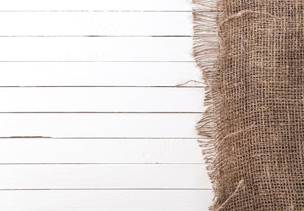 Biały Drewniany Tło Z Płótnem Premium Zdjęcia