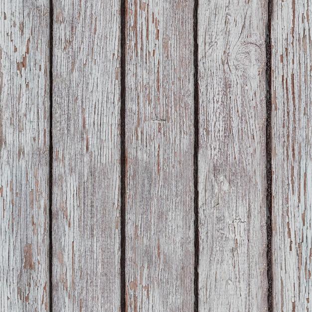 Bielona drewniana powierzchnia zużyta z powodu pogody. deski pomalowane na biało. tekstura drewnianej deski tło Premium Zdjęcia
