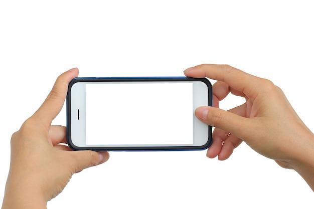 Biorąc zdjęcie z telefonu komórkowego na białym tle Premium Zdjęcia
