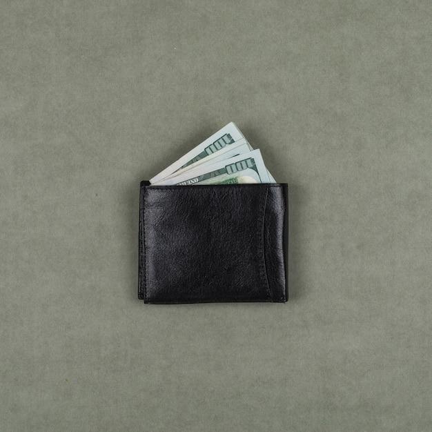 Biznesowy I Pieniężny Pojęcie Z Dolarami W Portflu Na Popielatym Nawierzchniowym Mieszkaniu Nieatutowym. Darmowe Zdjęcia