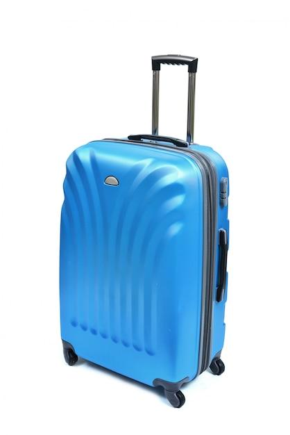 Błękitna Walizka Odizolowywająca Na Bielu Premium Zdjęcia