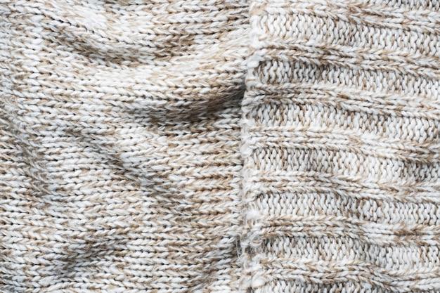 Bliska Beżowy Sweter Z Dzianiny Wykonany Z Naturalnej Tekstury Wełny Premium Zdjęcia