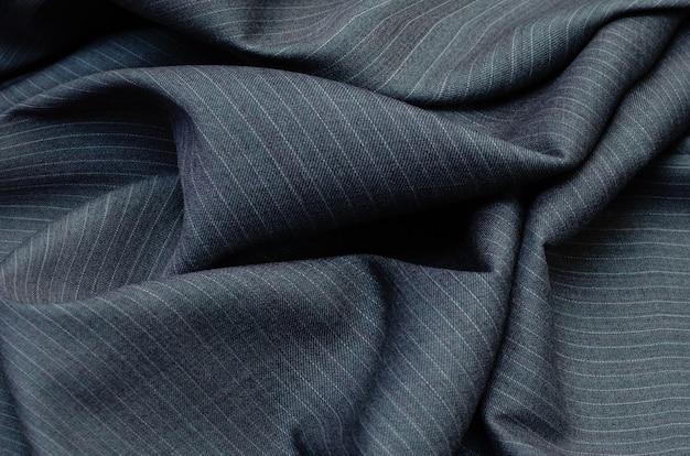Bliska Prążkowanych Tekstury Tkaniny Do Produkcji Odzieży W Kolorze Ciemnoszarym. Wełniany Materiał Na Kostiumy. Premium Zdjęcia