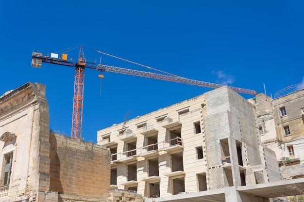 Bliski Wschód Budownictwo Mieszkaniowe, żuraw Przemysłowy Widok. Premium Zdjęcia