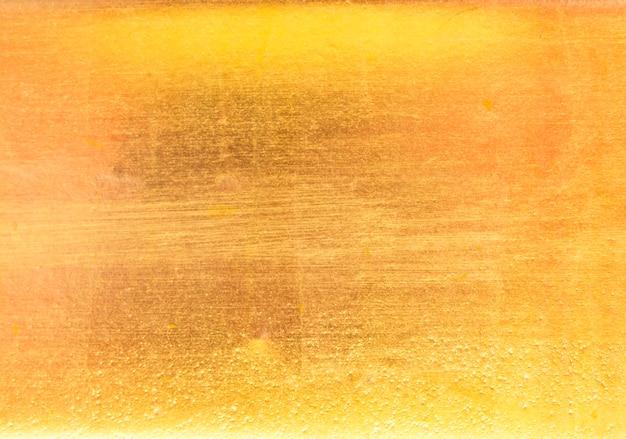 Błyszczący żółty liść złota tekstura Premium Zdjęcia