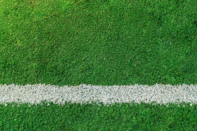 Boisko do piłki nożnej lub piłki nożnej z białą linią Premium Zdjęcia