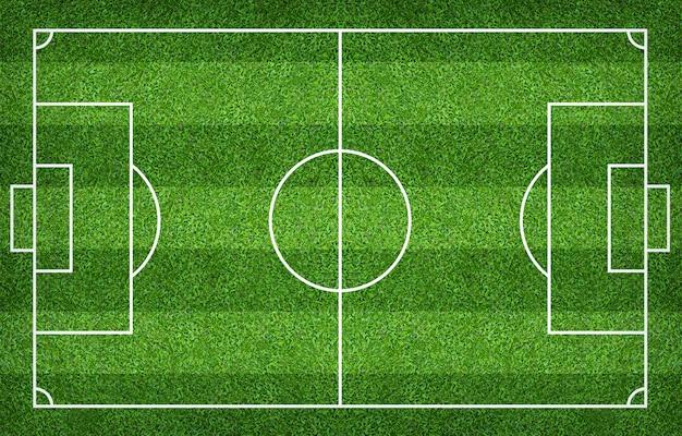 Boisko piłkarskie lub boisko do piłki nożnej dla tła. zielony kort do gry w trawnik. Premium Zdjęcia