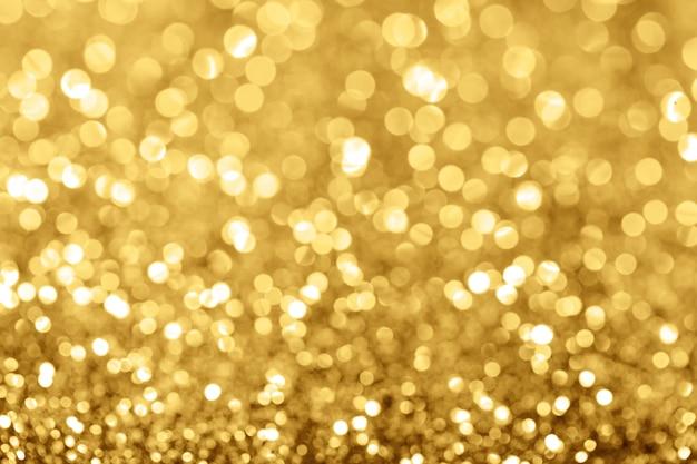 Bokeh złote tło wakacje Premium Zdjęcia