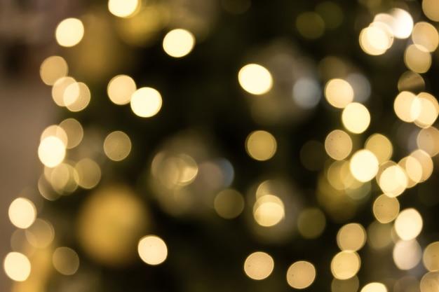 Boże Narodzenie Z Złotym Bokeh światła Tłem. Xmas Streszczenie Rozmycie. Premium Zdjęcia