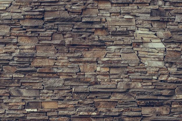 Brązowa Kamienna ściana, Granitowa Fasada. Premium Zdjęcia