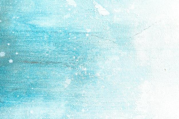 Brezentowy tekstury tło z abstrakcjonistycznym błękitnym kolorowym sztuka obrazem. Premium Zdjęcia