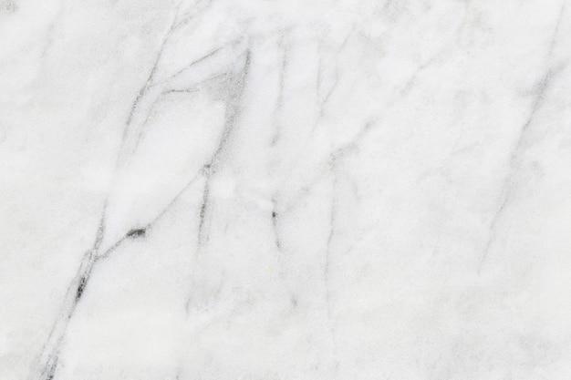 Brudne tekstury białego marmuru mają pył tła i wzór kamienia. Premium Zdjęcia