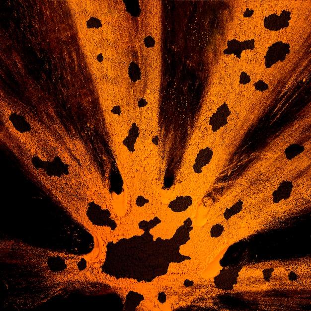 Bryzg Pomarańczowy Holi W Proszku Z Czarnymi Plamami Darmowe Zdjęcia