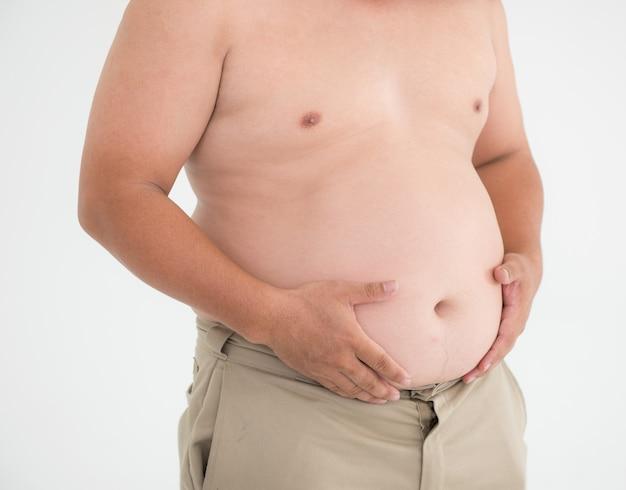 Brzuch Gruby Mężczyzna Na Białym Nadwaga Pojęcie Zdrowia Premium Zdjęcia