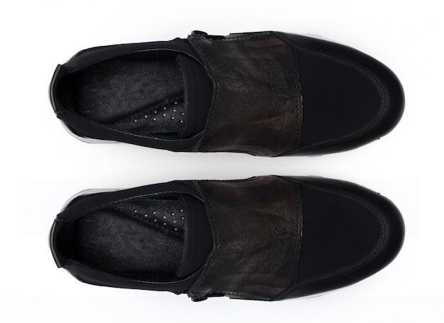 Buty odizolowywający na białym tle. Premium Zdjęcia