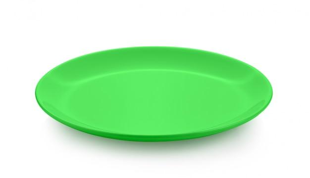 Ceramiczny Zielony Talerz Odizolowywający Na Biel Przestrzeni Premium Zdjęcia
