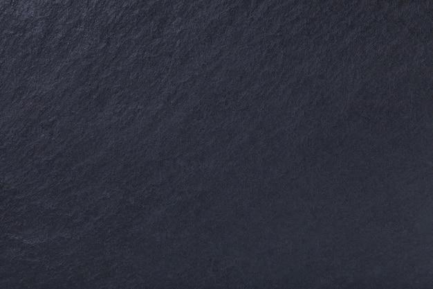 Ciemnoszary z naturalnego łupka. tekstura czarny kamień Premium Zdjęcia