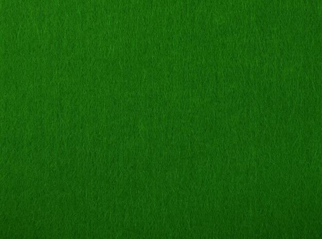 Ciemnozielony Stół Do Pokera Czuł Miękką Szorstką Teksturę Tła Materiału Tekstylnego, Bliska Premium Zdjęcia